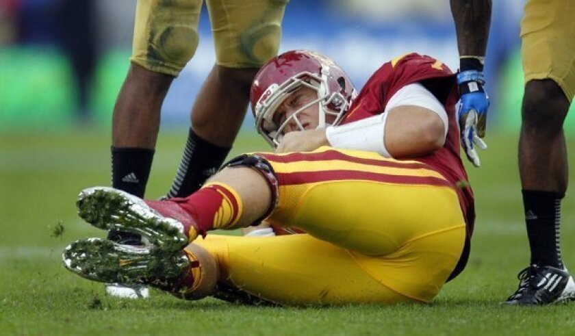 Matt Barkley winces in pain after being sacked during USC's loss to UCLA.
