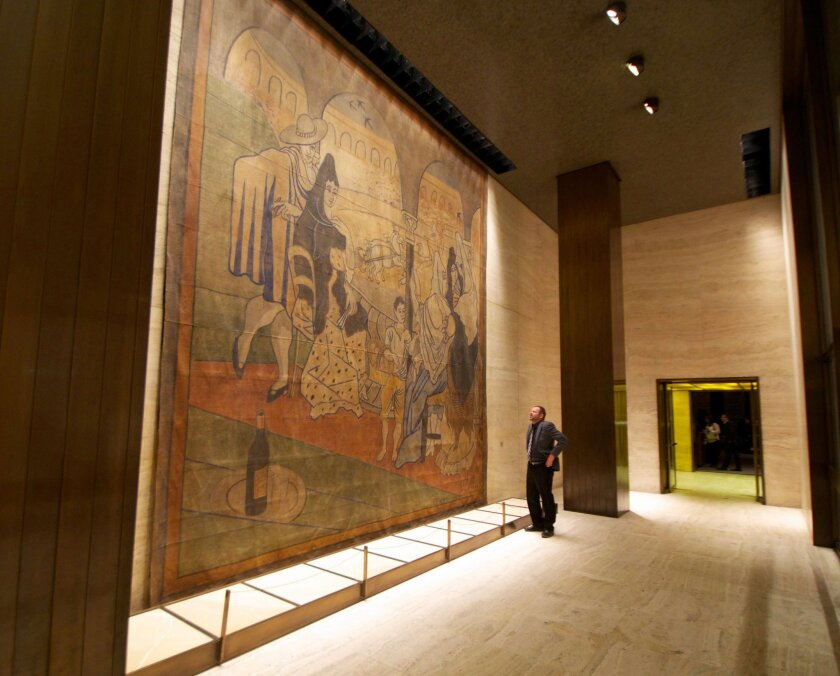 """FILE- In this Feb. 28, 2014, file photo provided by the New York Landmarks Conservancy, a stage curtain painted by Pablo Picasso hangs on a wall at the Four Seasons restaurant in New York. The 19-by-20-foot curtain, called """"Le Tricorne,"""" is being donated to the New-York Historical Society, painting owner the Landmarks Conservancy said on Thursday, June 12, 2014. The curtain was at the center of a legal dispute between the restaurant's landlord, who wanted it moved so the wall behind it can be repaired. (AP Photo/New York Landmarks Conservancy, Rick Bruner, File)"""