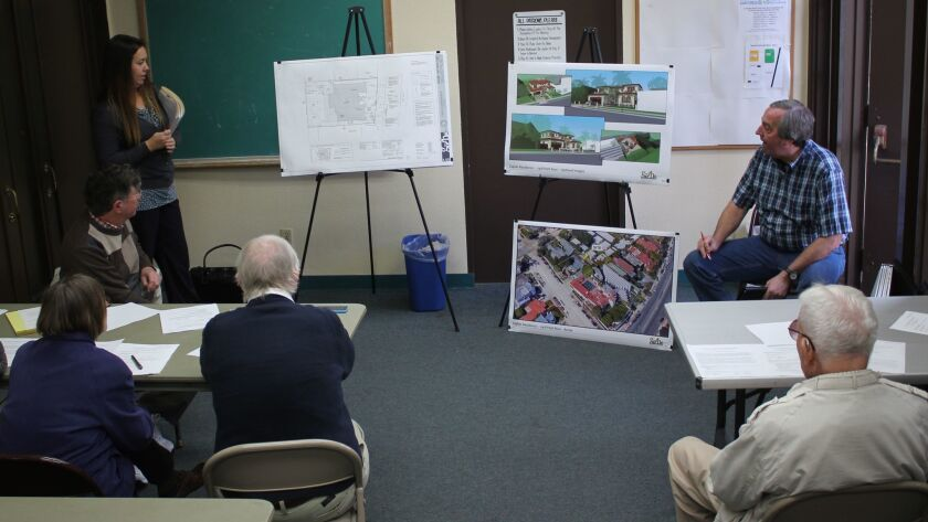 Applicants Sarah Horton and Tim Golba explain the details of the Caplan Residence project to DPR members.