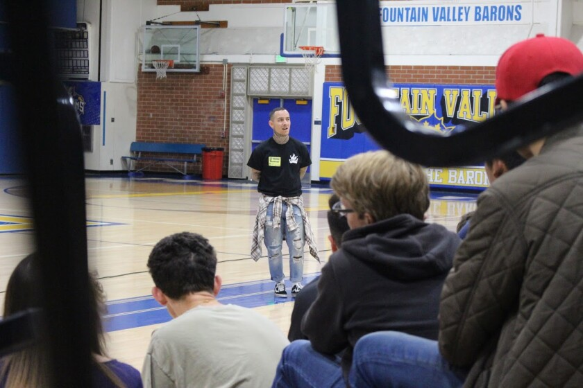 Youth pastor and Fountain Valley High School alumnus Manny Gallegos Jr. speaks to students.