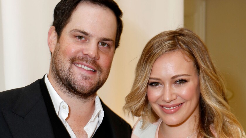 Mike Comrie and Hilary Duff, shown in 2012, split up in 2014 and just finalized their divorce.