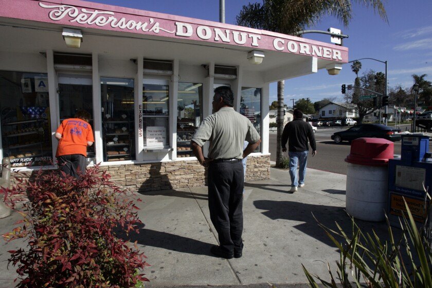 Customers line up to purchase donuts at Peterson's Donut Corner, a fixture in Escondido.