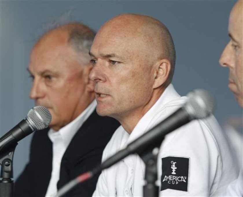 Stephen Barclay, center, CEO America's Cup Event Authority, speaks at a news conference, Friday, May 10, 2013, in San Francisco. At left is Iain Murray, Regatta Director and CEO, America's Cup Race Management and at right is Captain Matt Bliven of the United States Coast Guard. British Sailor Andrew Simpson died Thursday when Artemis Racing's AC72 catamaran, an America's Cup entry from Sweden, capsized during training in San Francisco Bay, trapping him underwater.(AP Photo/George Nikitin)