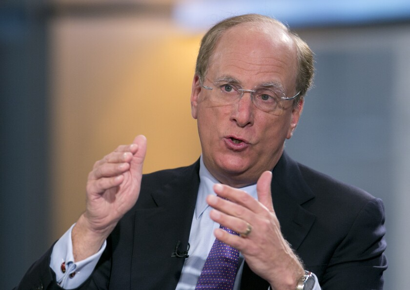 """FILE - In this March 26, 2014 file photo, BlackRock Chairman and CEO Laurence Fink is interviewed by Maria Bartiromo on Fox Business Network's """"Opening Bell with Maria Bartiromo,"""" in New York. BlackRock, the world's largest asset manager, is making climate change central to its investment decisions going forward. Fink, who oversees the management of about $7 trillion in funds, said in his influential annual letter to CEOs Tuesday, Jan. 14, 2020, that he believes we are """"on the edge of a fundamental reshaping of finance"""" because of a warming planet. (AP Photo/Mark Lennihan, File)"""