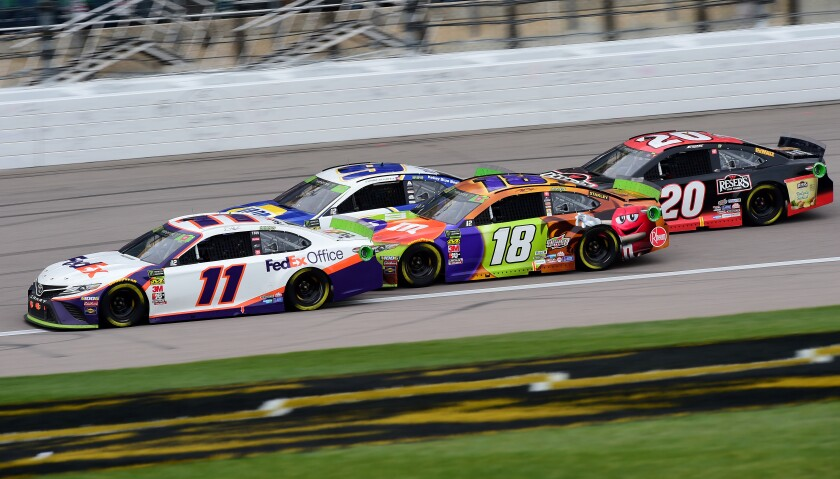Denny Hamlin (11) leads Chase Elliott (9), Kyle Busch (18) and Erik Jones (20) during the NASCAR race in Kansas City, Kan., on Sunday.