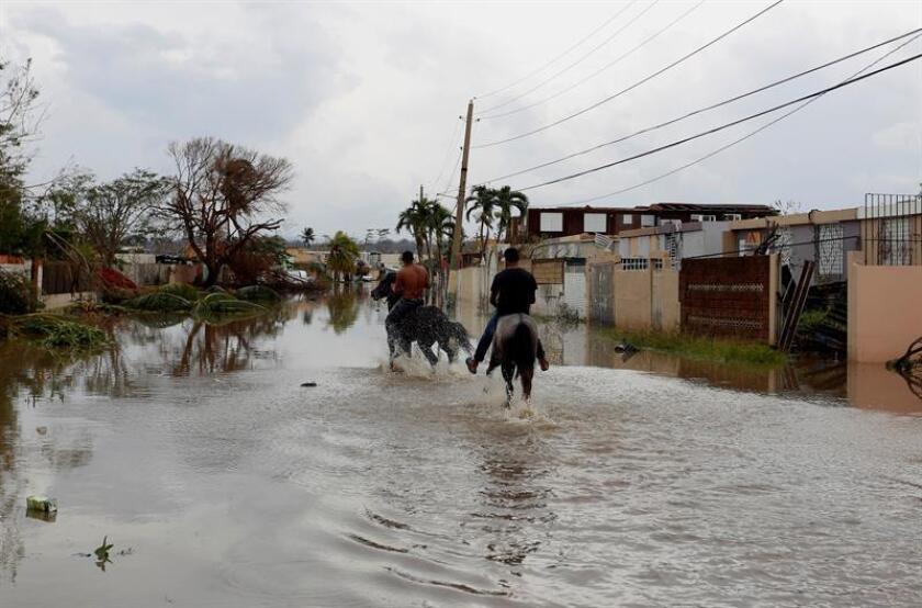 El Servicio Nacional de Meteorología (SNM) en San Juan emitió hoy una advertencia de inundaciones de corrientes urbanas y pequeñas en los municipios de San Juan y sus adyacentes de Trujillo Alto, Carolina, Guaynabo, Bayamón y Loíza hasta las 02.45 de la tarde (18.45 GMT) de este jueves. EFE/Archivo