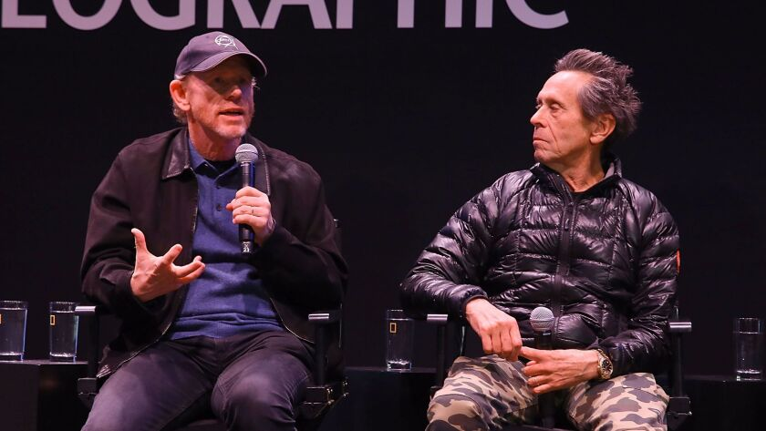 AUSTIN, TX - MARCH 12: (L-R) Ron Howard and Brian Grazer speak onstage at the Genius Panel at the