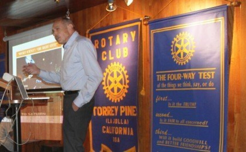 UCSD research physicist John Asmus speaks to the Torrey Pines of La Jolla Rotary Club about his research to help determine the veracity of a second 'Mona Lisa.'