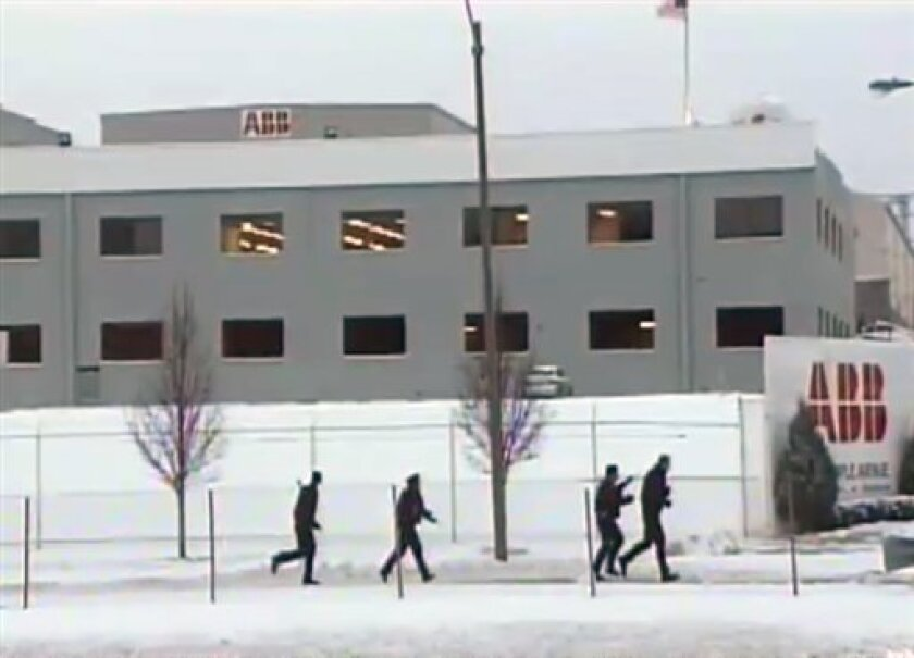 This image made from KDSK-TV video, shows police responding to a shooting at the ABB Power Plant in St. Louis, Mo. Thursday morning Jan. 7, 2010. A man with an assault rifle walked into a business Thursday and shot at least three people, police said. (AP Photo/Courtesy KDKS-TV) MANDATORY CREDIT
