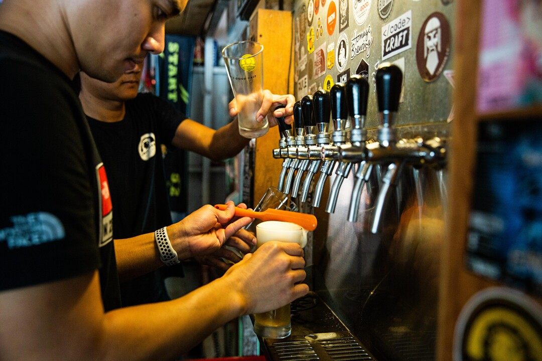 Bartenders serve beer at Chit Beer, a Thai craft brewery on Koh Kret island, upriver from Bangkok.