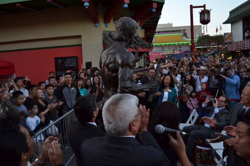 Several hundred people turned out for the unveiling of a Bruce Lee statue.