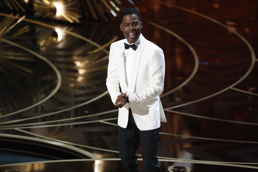 Chris Rock delivers the opening monologue at the Oscars.