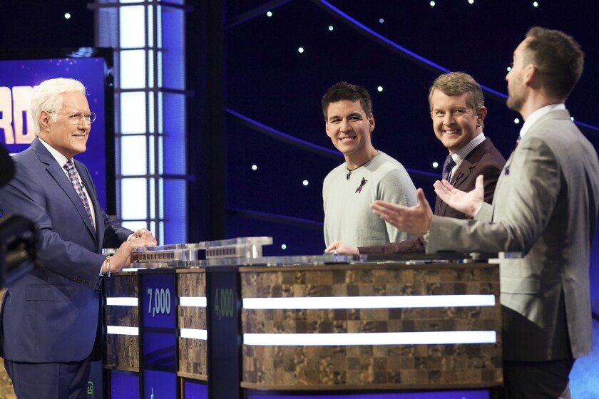"Host Alex Trebek, left, with contestants James Holzhauer, Ken Jennings and Brad Rutter on ""Jeopardy! Greatest of All Time."""