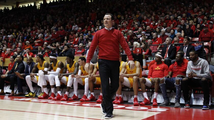 New Mexico head coach Paul Weir walks the sidelines during the first half of an NCAA college basketb