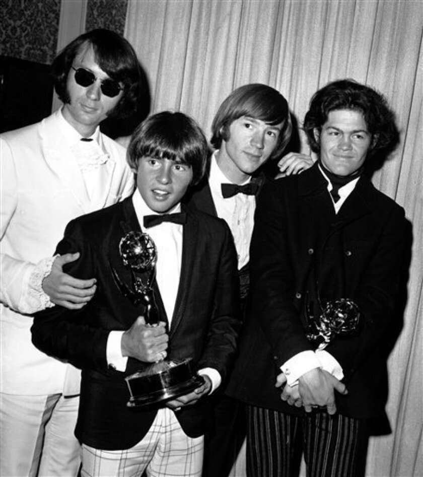 FILE - This June 4, 1967 file photo shows The Monkees posing with their Emmy award at the 19th Annual Primetime Emmy Awards in Calif. The group members are, from left to right, Mike Nesmith, Davy Jones, Peter Tork, and Micky Dolenz. Jones died Wednesday Feb. 29, 2012 in Florida. He was 66. Jones ro