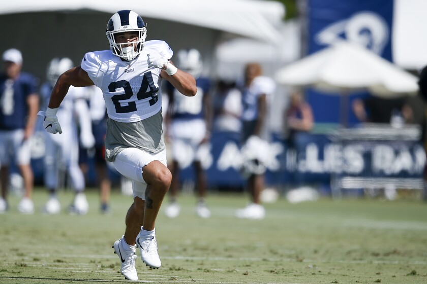 Rams safety Taylor Rapp sprints during a training camp session on July 29.