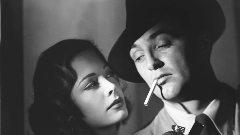 "Jane Greer and Robert Mitchum in ""Out of the Past."""