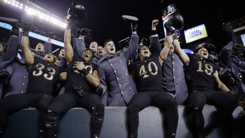 Army players celebrate a victory over Navy after an NCAA college football game, Saturday, Dec. 8, 20