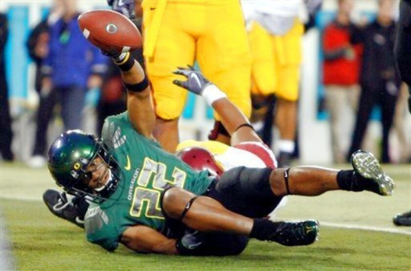 Oregon's Andre Crenshaw celebrates after scoring against USC in the second quarter Saturday in Eugene.