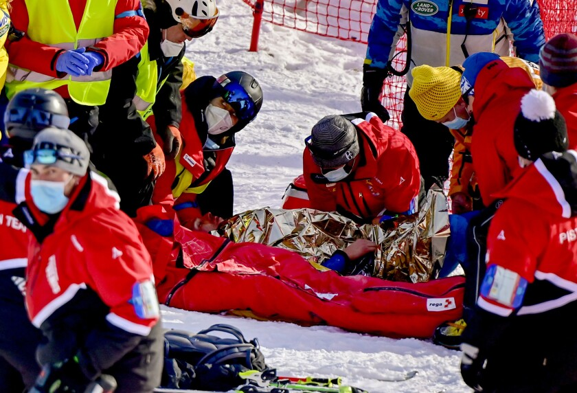 Injured Tommy Ford from the US during the first run of the men's giant slalom race at the FIS Alpine Skiing World Cup in Adelboden, Switzerland, Saturday, January 9, 2021. (Jean-Christophe Bott/Keystone via AP)