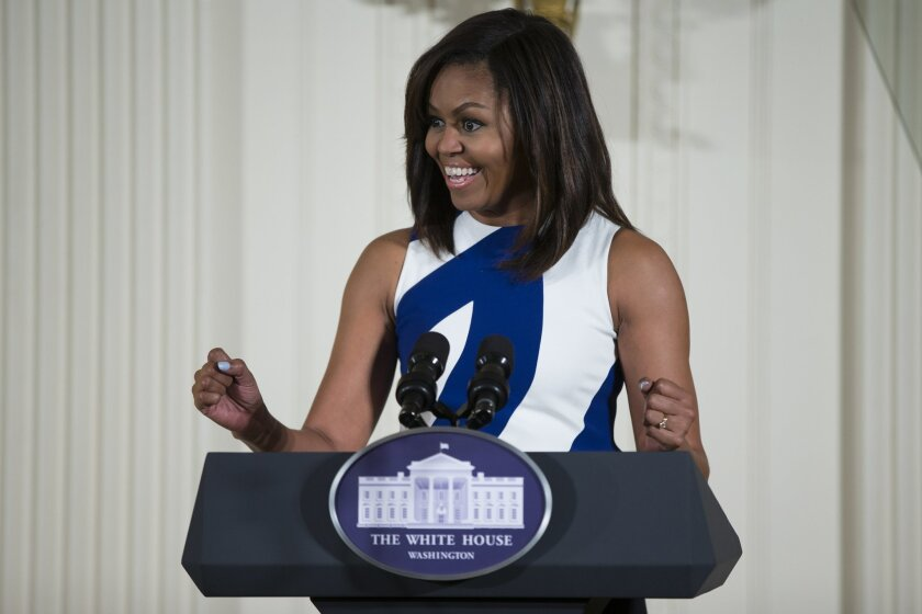 """FILE- In this June 1, 2016 file photo, first lady Michelle Obama speaks in the East Room of the White House in Washington. Michelle Obama's """"Carpool Karaoke"""" joyride with James Corden will air Wednesday, July 20, on the late-night host's CBS show. The first lady and Corden sing """"This Is For My Girl"""