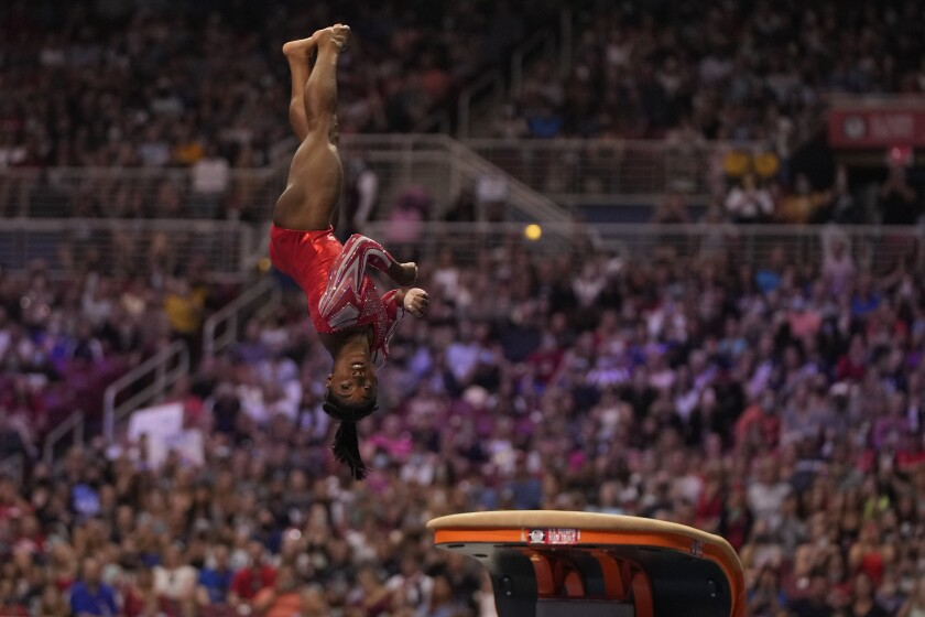 Simone Biles competes on the vault during the women's U.S. Olympic gymnastic trials in June.