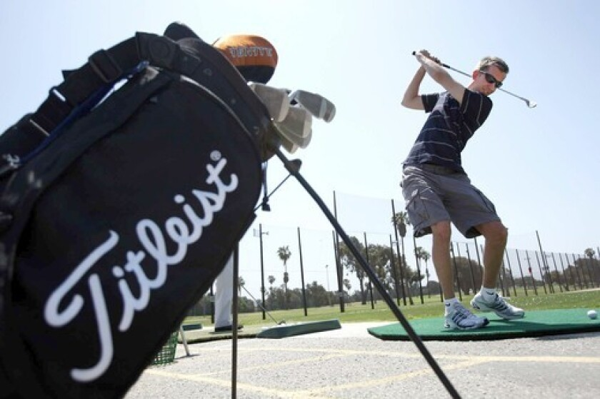 Michael Van Gorkom practices his swing at the driving range in Westchester. Other funemployed travel on the cheap for weeks, head back to school or volunteer.