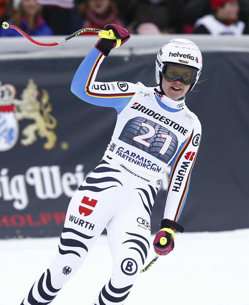 Germany's Viktoria Rebensburg reacts at the finish area after completing an Alpine Ski women's World Cup Super G race, in Garmisch Partenkirchen, Germany, Sunday, Feb. 7, 2016. (AP Photo/Gio Auletta)