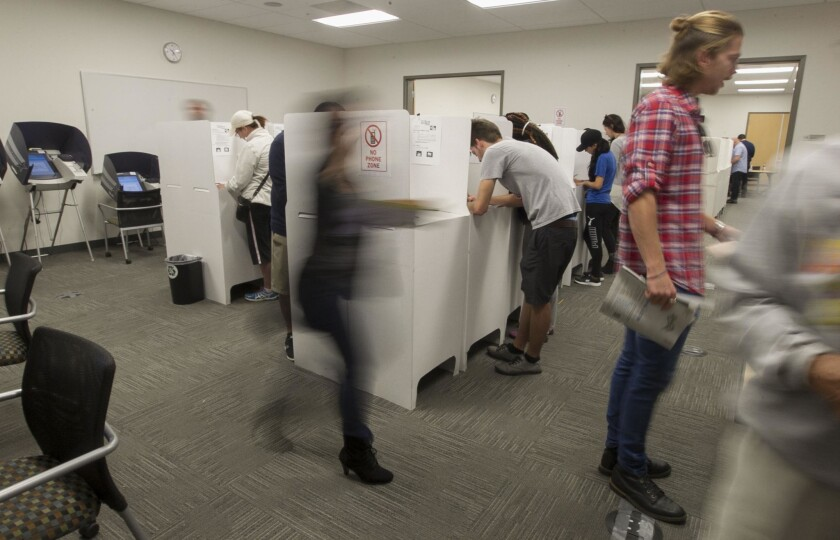 People with lots of different reasons for voting early cast their votes at the Registrar of Voters office in Kearny Mesa the day before the election.