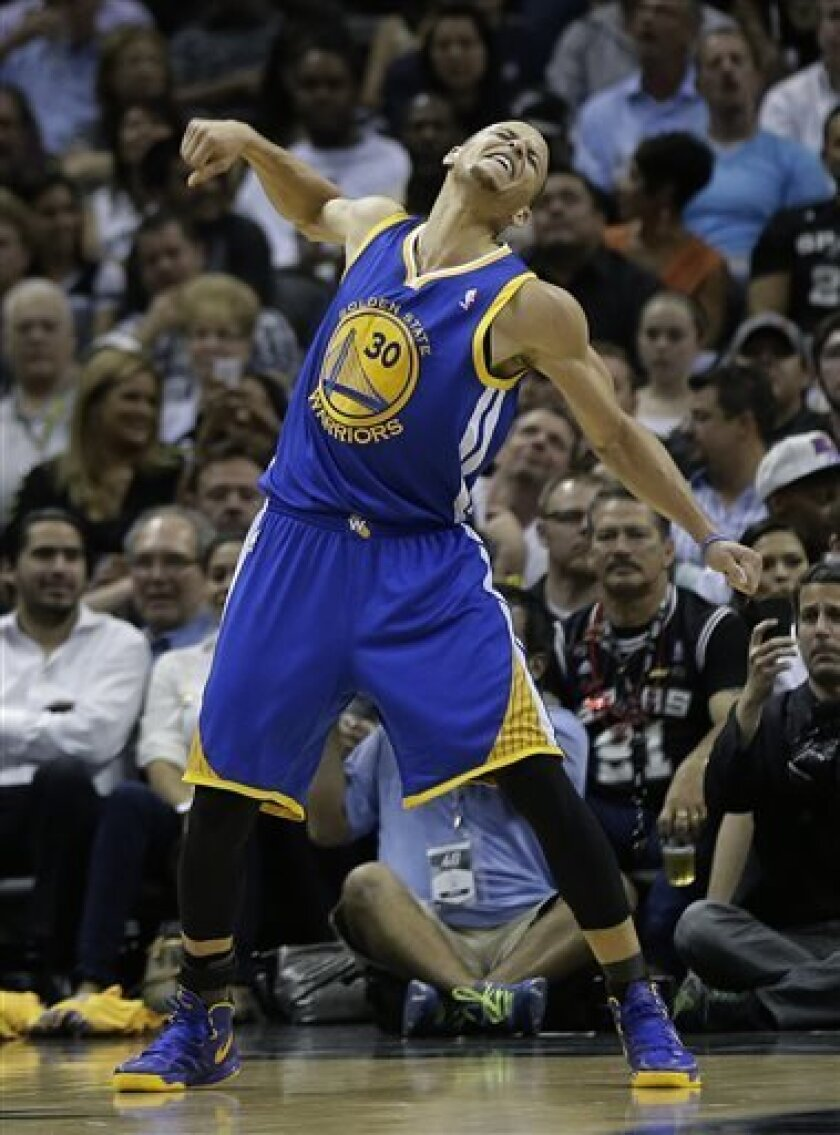 Golden State Warriors' Stephen Curry reacts during the second half of Game 1 of a Western Conference semifinal NBA basketball playoff series against the San Antonio Spurs, Monday, May 6, 2013, in San Antonio. San Antonio won 129-127 in double overtime. (AP Photo/Eric Gay)