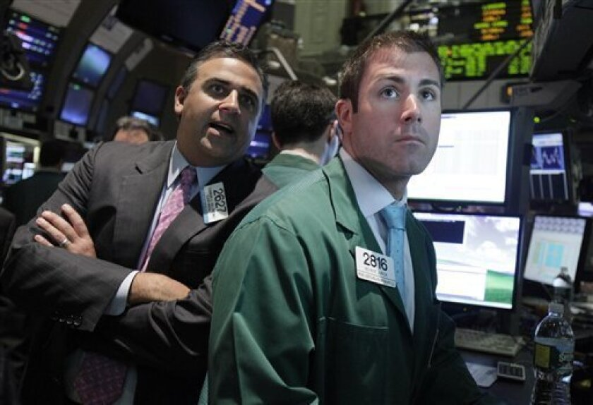 Specialists Damian Valentino, left, and Kevin Jurick work on the floor of the New York Stock Exchange Tuesday, June 1, 2010. (AP Photo/Richard Drew)