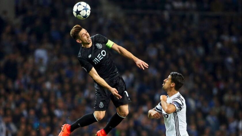 FC Porto's Hector Herrera goes airborne for a header against Juventus' Sami Khedira during a UEFA Champions League game in February.