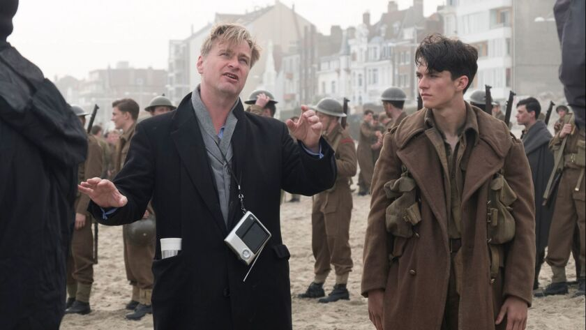 "Director Christopher Nolan and actor Fionn Whitehead on the set of the World War II action thriller ""Dunkirk."""