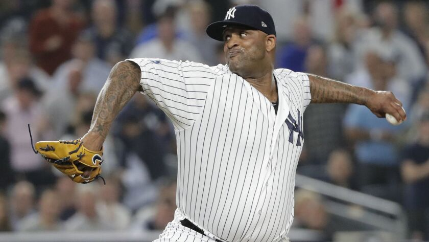 FILE - In this Tuesday, Oct. 9, 2018 file photo, New York Yankees starting pitcher CC Sabathia deliv