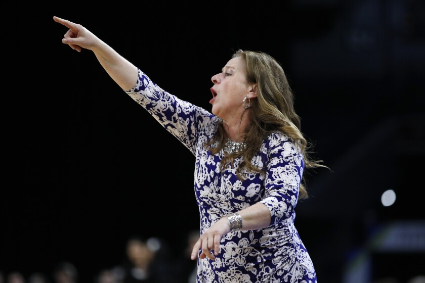UCLA head coach Cori Close motions toward the court during the first half against Stanford in the semifinal round of the Pac-12 women's tournament on March 7 in Las Vegas.
