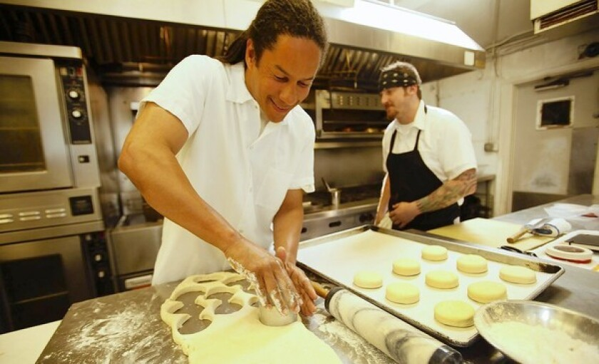 Chef Govind Armstrong, left, with chef Greg Zanotti, prepares biscuits in the kitchen of his Willie Jane restaurant in Venice.