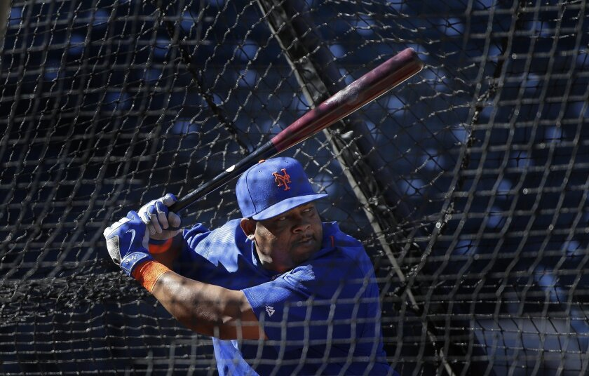 New York Mets' Juan Uribe, who started the season with the Dodgers, takes batting practice on Oct. 23.