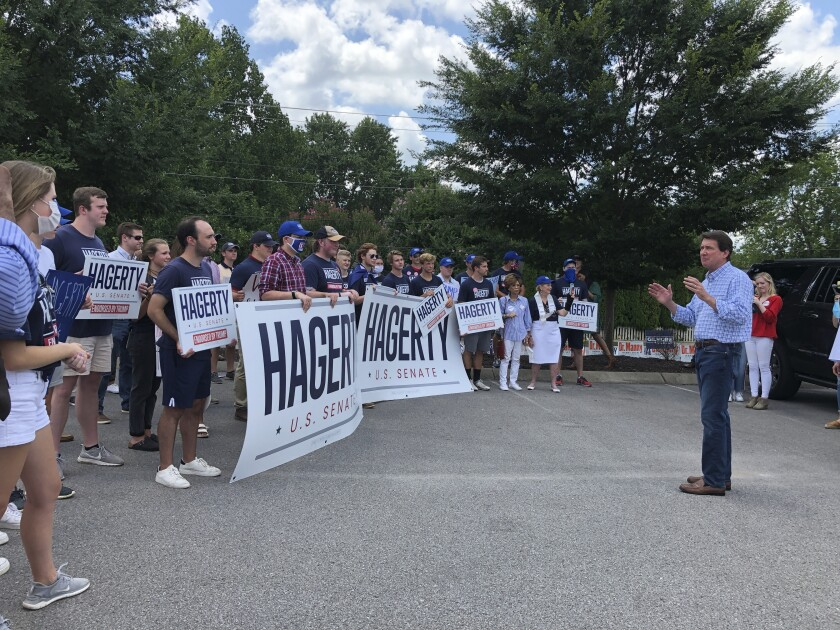 Republican U.S. Senate candidate Bill Hagerty speaks to supporters on Friday, July 17, 2020, after casting an early voting ballot at the Nashville Public Library Bellevue Branch in Nashville, Tenn. (AP Photo/Jonathan Mattise)