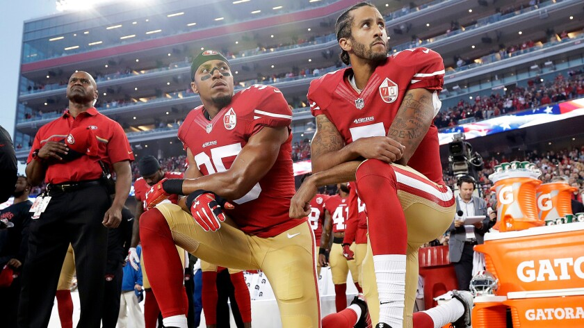 San Francisco 49ers safety Eric Reid (35) and quarterback Colin Kaepernick (7) kneel during the national anthem on Sept. 12 in Santa Clara, Calif.