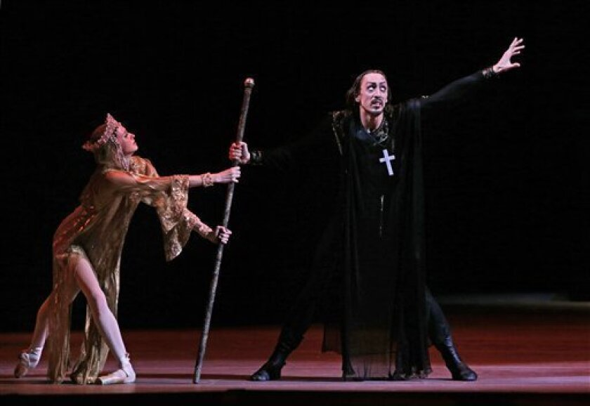 FILE - In this Sunday, Nov. 4, 2012 file photo, Russian dancer Pavel Dmitrichenko, as Ivan the Terrible, right, and ballerina Anna Nikulina as Anastasia, wife of Ivan the Terrible perform at a dress rehearsal of Ivan the Terrible (Russian Tsar Ivan the Terrible) in the Bolshoi Theater in Moscow, Ru