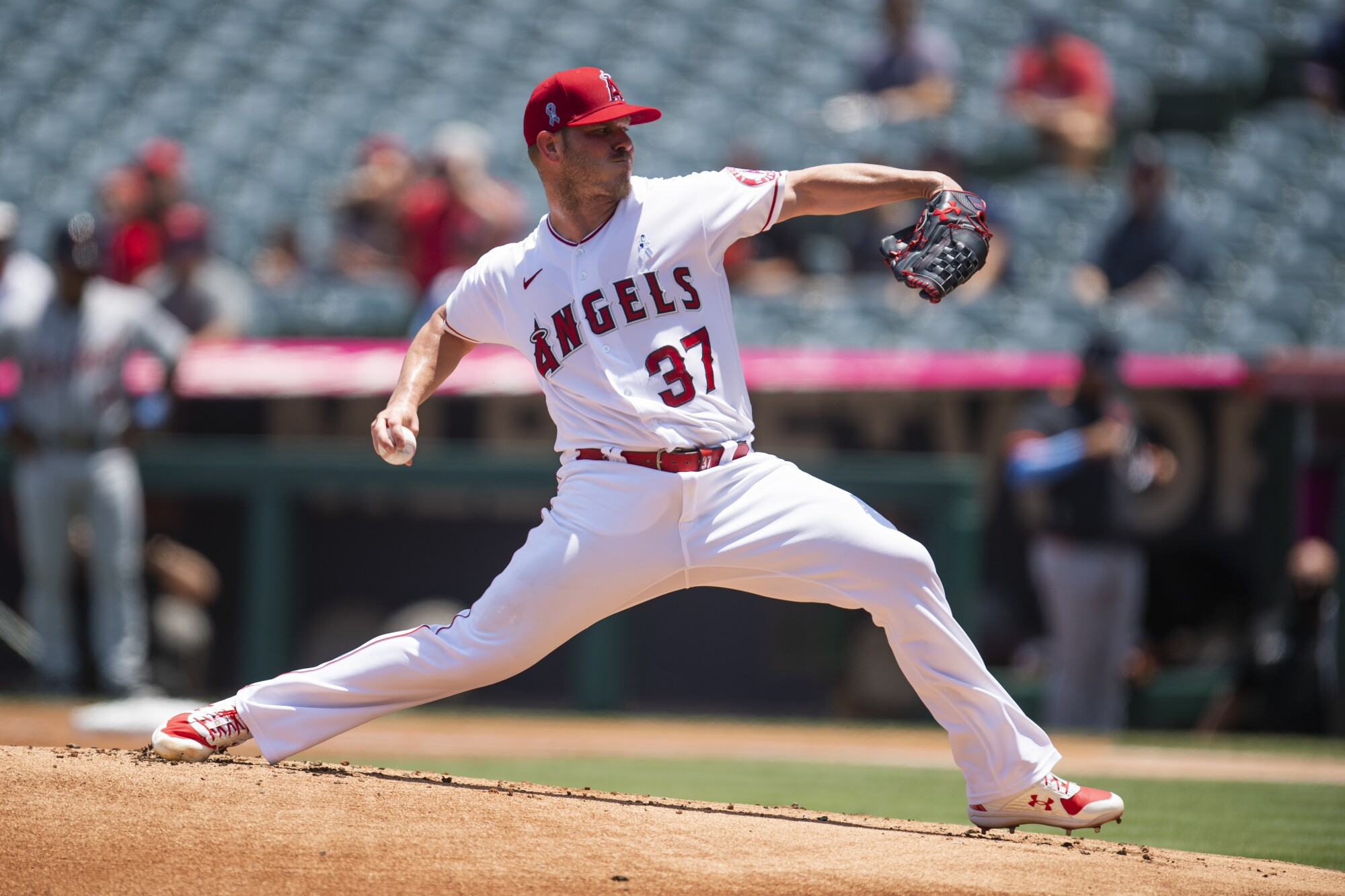 Angels starting pitcher Dylan Bundy delivers during the first inning against the Detroit Tigers on Sunday.