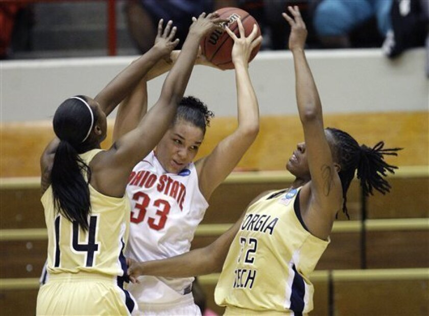 Ohio State's Ashley Adams, center, tries to break the press as Georgia Tech's LaQuananisha Adams, left, and Chelsea Regins defend during the first half of a second-round NCAA women's college basketball tournament game Monday, March 21, 2011, in Columbus, Ohio. (AP Photo/Jay LaPrete)