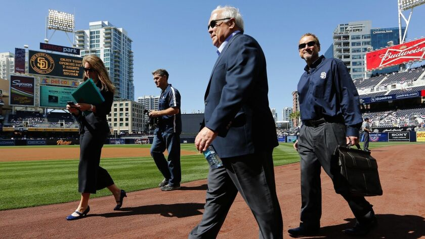 Padres ownership members Ron Fowler (center) and Peter Seidler (right) walk on the field before on opening day for the San Diego Padres Tuesday at Petco Park.