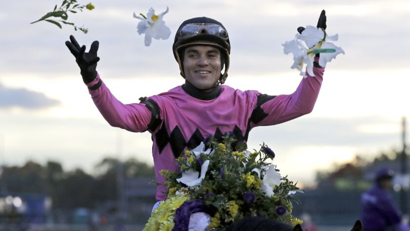 Joel Rosario celebrates after riding Game Winner to victory in the Breeders' Cup Juvenile horse race
