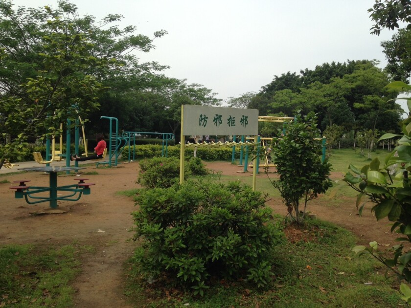"""A sign near the exercise equipment at the Anti-Cult Theme Park in Wenzhou, China, says, """"Prevent cults; resist cults."""""""