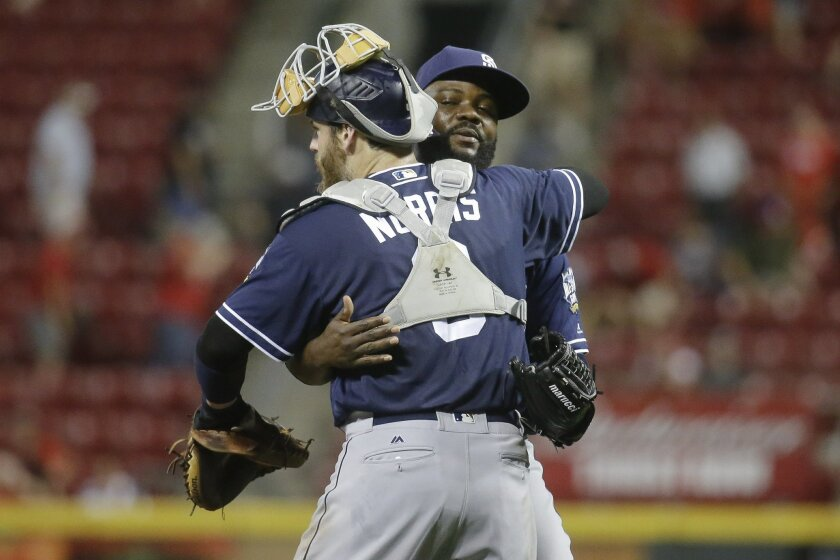 San Diego Padres relief pitcher Fernando Rodney, right, celebrates with catcher Derek Norris (3) after closing the ninth inning of a baseball game against the Cincinnati Reds, Thursday, June 23, 2016, in Cincinnati. (AP Photo/John Minchillo)