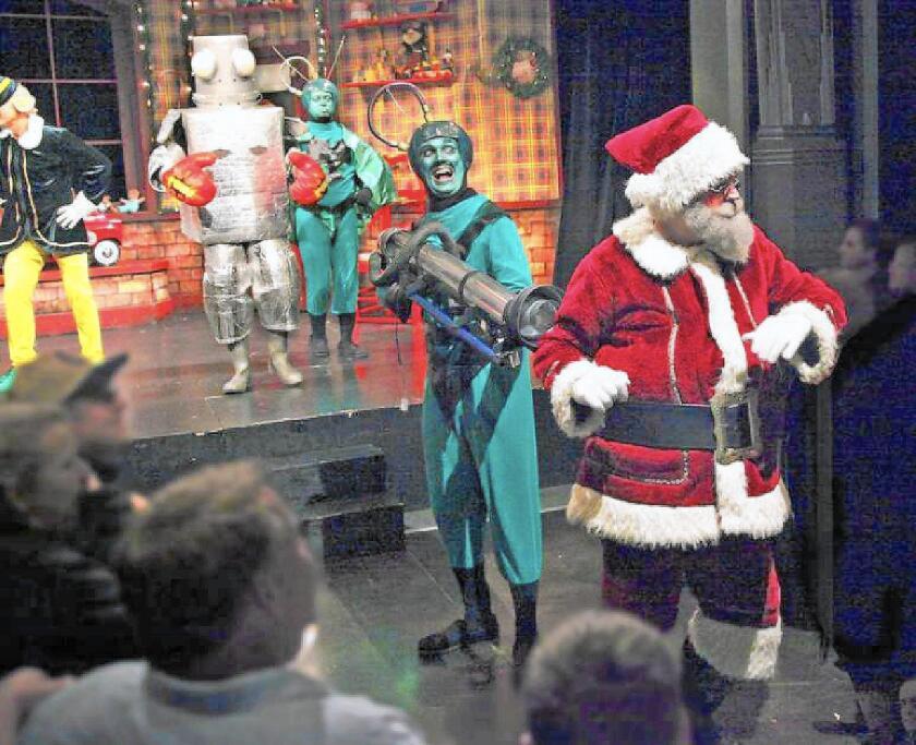 "Joe Sanders, Robert Nunez, Nathan Makaryk and Nick McGee in ""Santa Claus Conquers the Martians"" at Fullerton's Maverick Theater."