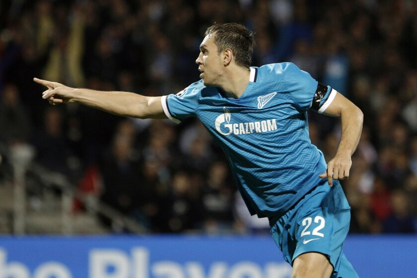 Zenit's Artyom Dzyuba celebrates after scoring the opening goal during the Champions League Group H soccer match against Lyon at the Gerland stadium in Lyon, central France, Wednesday, Nov. 4, 2015. (AP Photo/Laurent Cipriani)