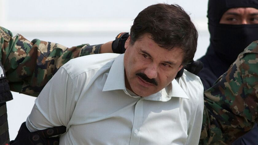 """Joaquin """"El Chapo"""" Guzman, the head of Mexico's Sinaloa cartel, is taken to a helicopter in Mexico City following his capture overnight in the beach resort town of Mazatlan on Feb. 22, 2014."""