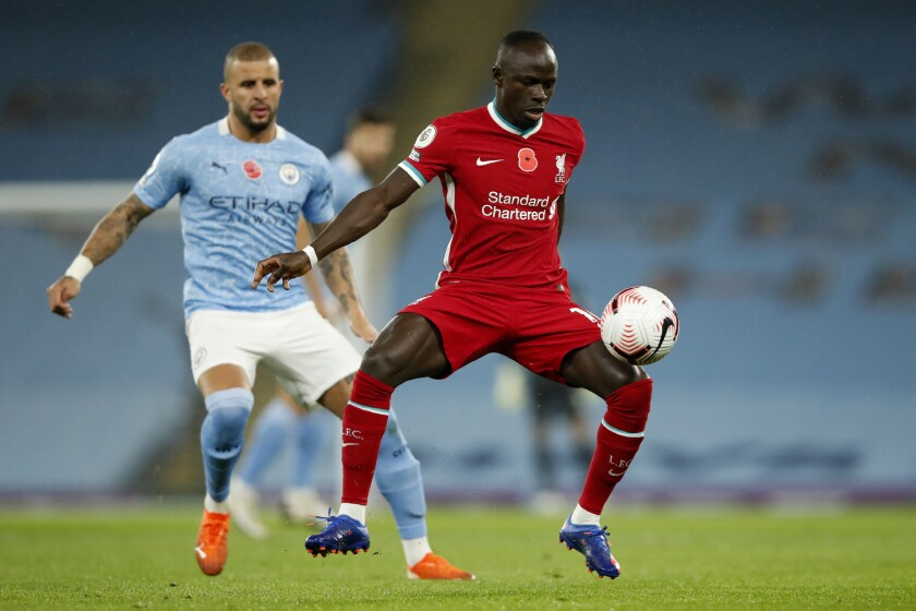 Liverpool's Sadio Mane controls the ball during the English Premier League soccer match between Manchester City and Liverpool at the Etihad stadium in Manchester, England, Sunday, Nov. 8, 2020. (Clive Brunskill/Pool via AP)